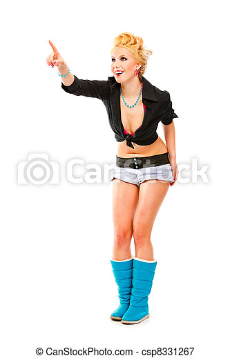 Full length portrait of cheerful modern girl pointing finger at copy space isolated on white - csp8331267
