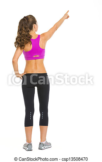 Full length portrait of fitness young woman pointing on copy space . rear view - csp13508470