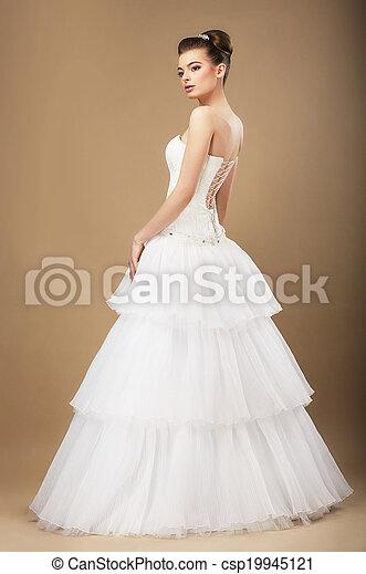 Full Length Portrait of Graceful Bide in White Wedding Dress - csp19945121