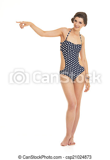 Full length portrait of happy young woman in swimsuit pointing o - csp21024873