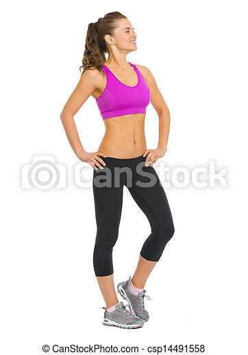 Full length portrait of healthy young woman looking on copy space - csp14491558
