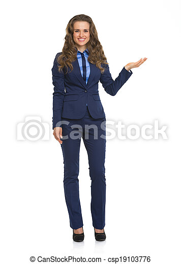 Full length portrait of smiling business woman pointing on copy space - csp19103776