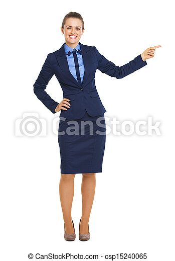 Full length portrait of smiling business woman pointing on copy space - csp15240065