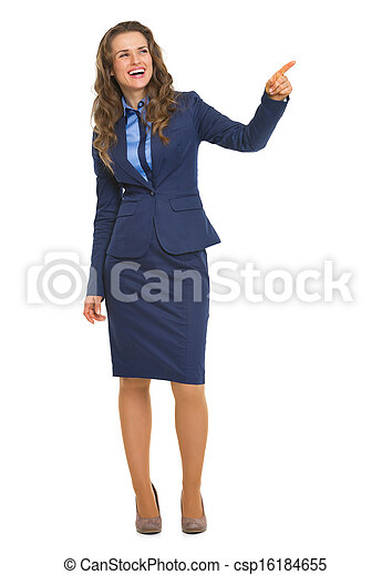 Full length portrait of smiling business woman pointing on copy space - csp16184655