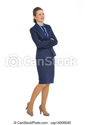 Full length portrait of smiling business woman looking on copy space - csp14006040