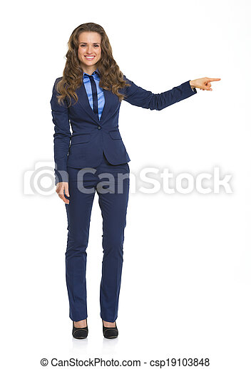 Full length portrait of smiling business woman pointing on copy space - csp19103848