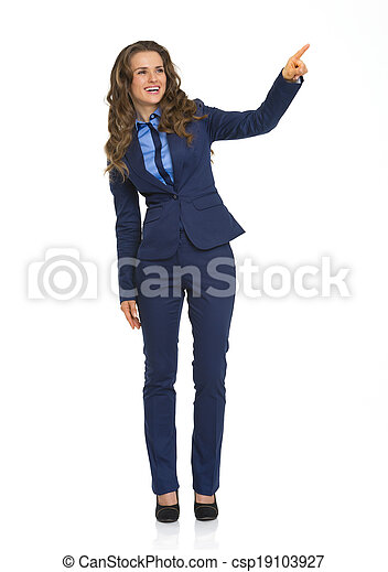 Full length portrait of smiling business woman pointing on copy space - csp19103927