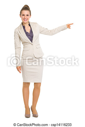 Full length portrait of smiling business woman pointing on copy space - csp14116233