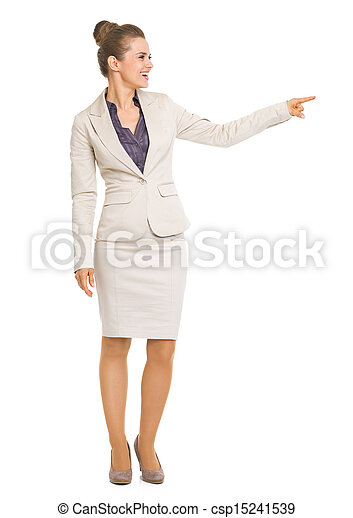 Full length portrait of smiling business woman pointing on copy space - csp15241539