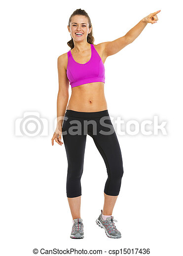 Full length portrait of smiling fitness young woman pointing on copy space - csp15017436