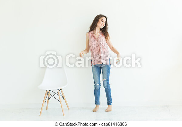 Full length portrait of young lady on white background with copy space - csp61416306