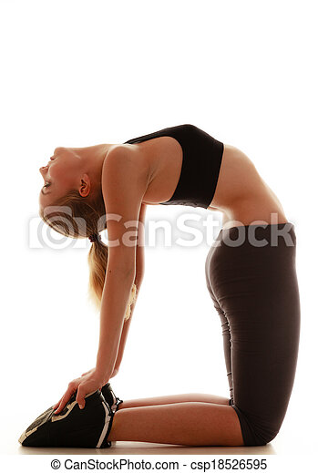 Full length sporty woman doing stretching exercise camel isolated - csp18526595