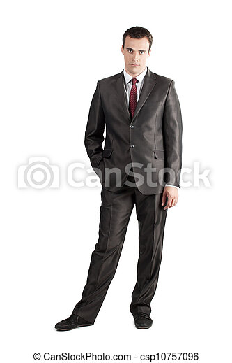 full length suit tie businessman with hand in pocket - csp10757096