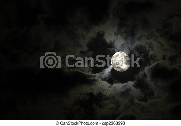 Full moon and eerie white clouds against a black night sky - csp2363393