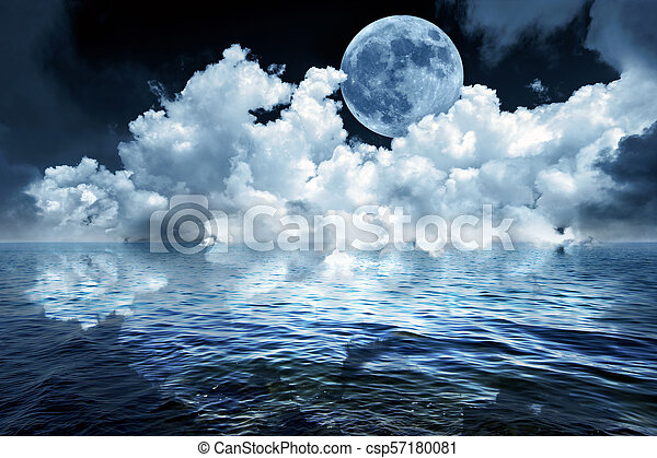 Full moon in night sky over the ocean reflecting in water - csp57180081