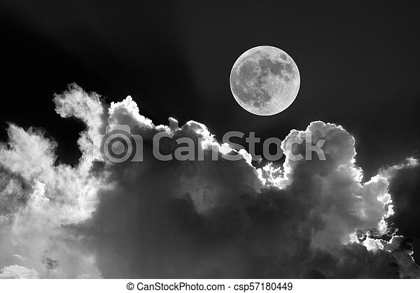 Full moon in night sky with dreamy moonlit clouds - csp57180449