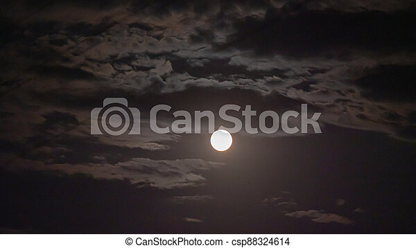 full moon in the sky with clouds - csp88324614
