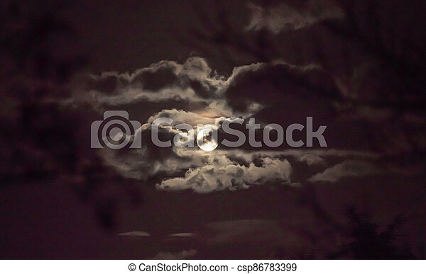 full moon in the sky with clouds - csp86783399