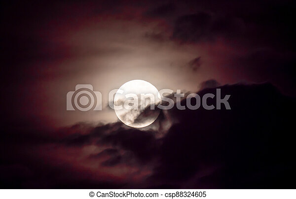 full moon in the sky with clouds - csp88324605