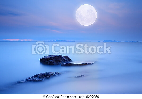 Full moon over blue sea and sky ,Long exposure technique - csp16297056