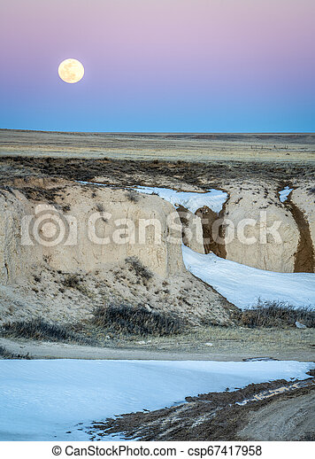 Full moon rise over prairie - csp67417958