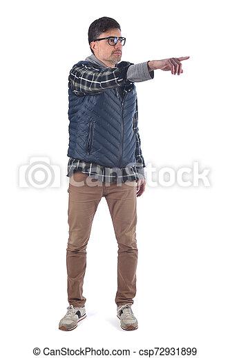 full portrait of a man pointig on white background - csp72931899