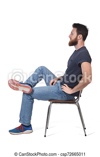 full portrait of a man sitting on a chair on white - csp72665011