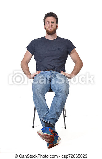 full portrait of a man sitting on a chair on white - csp72665023