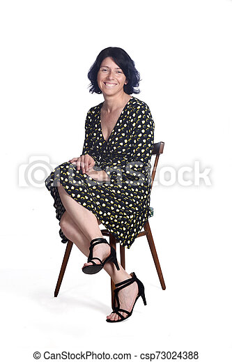 full portrait of a sitting woman on white - csp73024388