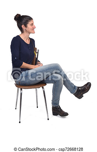 full portrait of a woman sitting on a chair cross-legged and looking to the side on white background - csp72668128