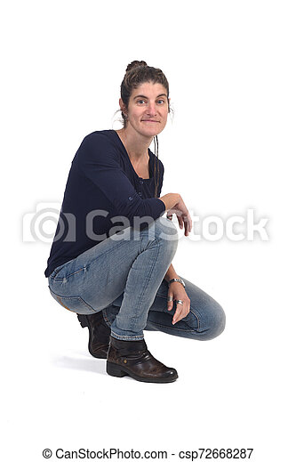 full portrait of woman sitting in the floor on white - csp72668287