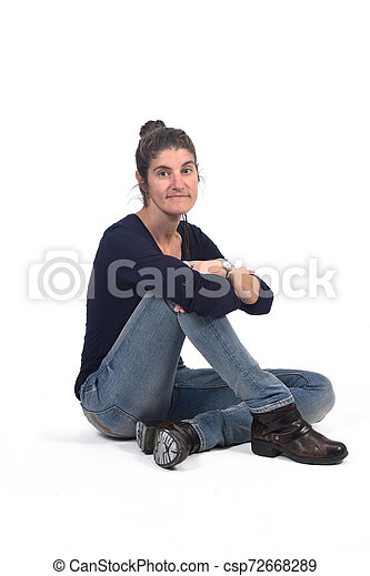 full portrait of woman sitting in the floor on white - csp72668289