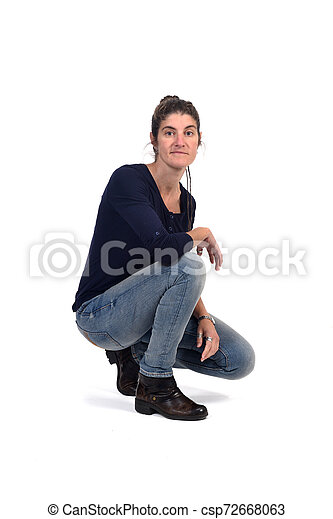 full portrait of woman sitting in the floor on white - csp72668063