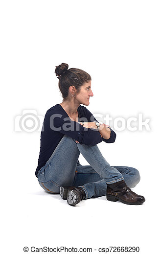 full portrait of woman sitting in the floor on white - csp72668290