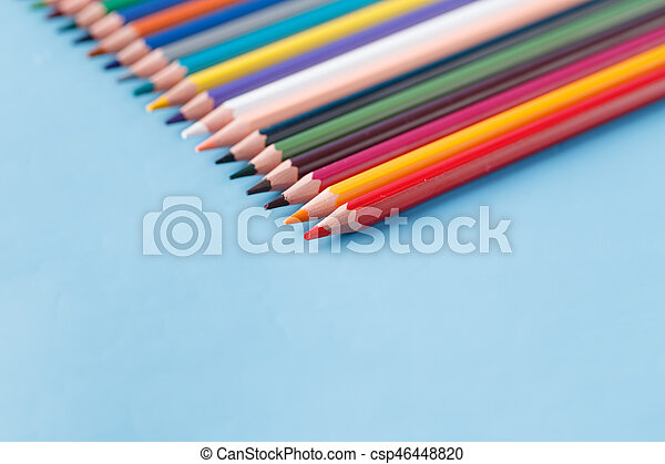 Full row of multycolor pencils on blue background - csp46448820