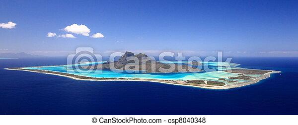 Full View of Bora Bora Lagoon, French Polynesia from above on a near cloudless day. Prime honeymoon destination  - csp8040348