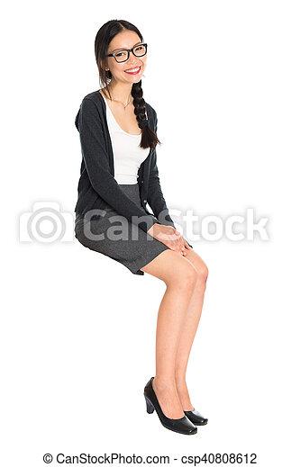 Fullbody young Asian girl sitting - csp40808612
