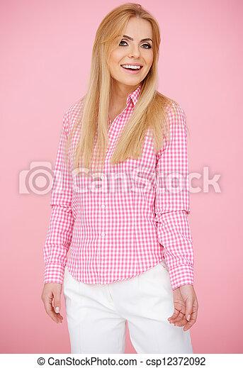 Fun Blond Woman in Pink - csp12372092