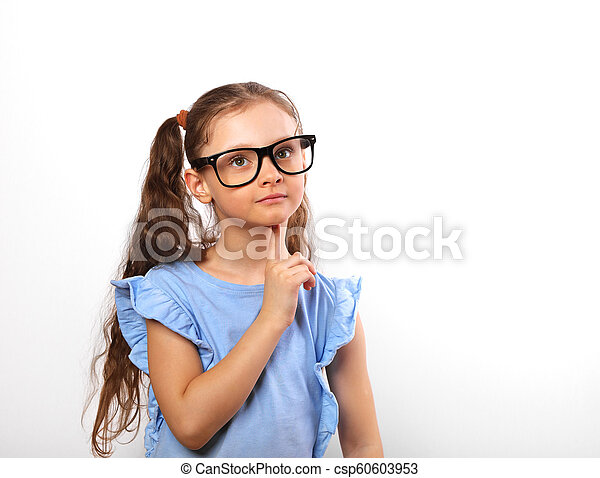 Fun grimacing happy girl in eye glasses thinking and looking up on background with empty copy spase. - csp60603953