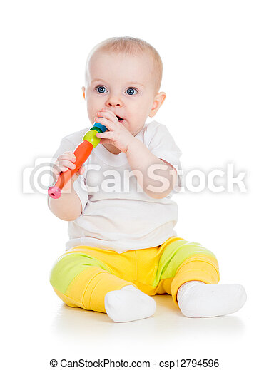 Funny baby  girl playing with musical toy. Isolated on white background - csp12794596