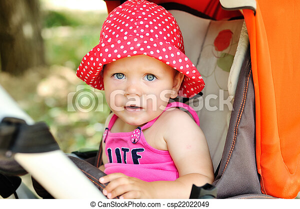 funny baby in stroller - csp22022049