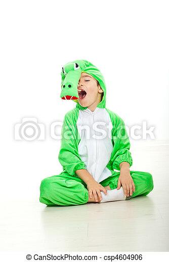 Funny boy in crocodile oufit - csp4604906