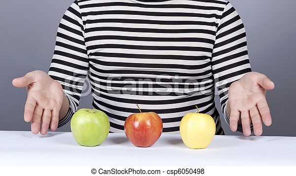 Funny boy show to eat apples. - csp6050498