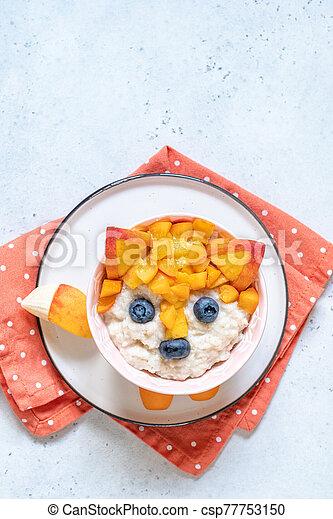 Funny Breakfast For Kids Oatmeal Porridge. - csp77753150