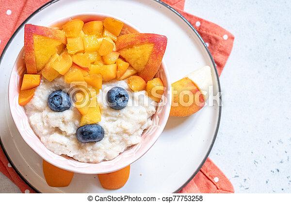 Funny Breakfast For Kids Oatmeal Porridge. - csp77753258