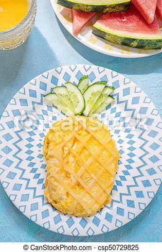 Funny Breakfast for kids - omelette look like pineapple - csp50729825