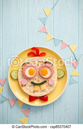 Funny breakfast for kids with face shape sandwich - csp85370407