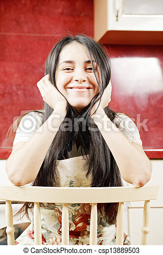 Funny brunette woman sitting on chair - csp13889503