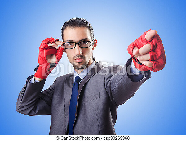 Funny businessman with boxing gloves - csp30263360