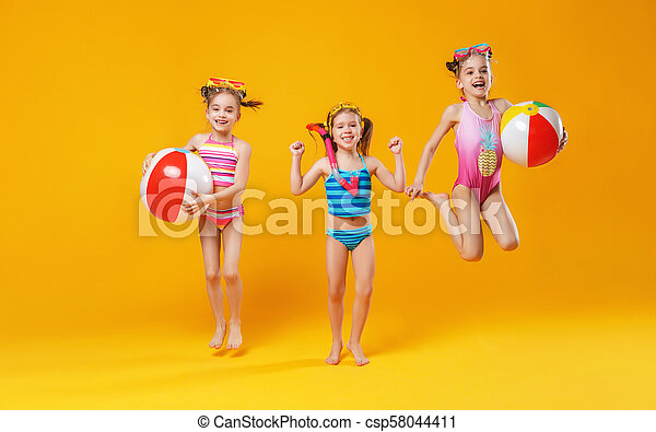 8cc0b91815 funny funny happy children in bathing suits jumping on colored background